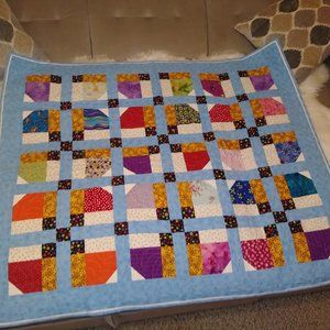Baby quilt multi colored patch work hand crafted